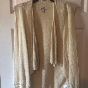 Cream colored pull over cardigan vest.